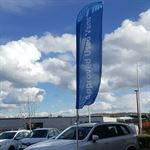 Curved Automotive Forecourt Flag and Pole